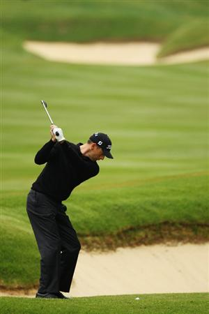 VIRGINIA WATER, ENGLAND - MAY 20:  Soren Hansen of Denmark plays an iron shot on the 3rd hole during the first round of the BMW PGA Championship on the West Course at Wentworth on May 20, 2010 in Virginia Water, England.  (Photo by Ross Kinnaird/Getty Images)