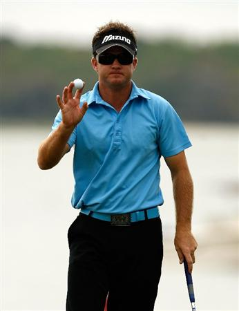 HILTON HEAD ISLAND, SC - APRIL 18:  Brian Gay waves to the fans on the 18th hole during the third round of the Verizon Heritage at Harbour Town Golf Links on April 18, 2009 in Hilton Head Island, South Carolina.  (Photo by Streeter Lecka/Getty Images)