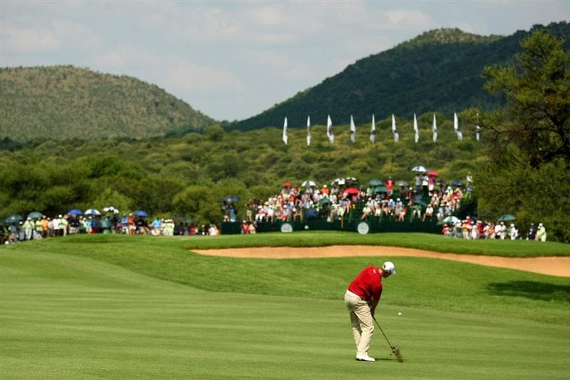 SUN CITY, SOUTH AFRICA - DECEMBER 07:  Henrik Stenson of Sweden plays into the 10th green during the final round of the Nedbank Golf Challenge at the Gary Player Country Club on December 7, 2008 in Sun City, South Africa.  (Photo by Richard Heathcote/Getty Images)