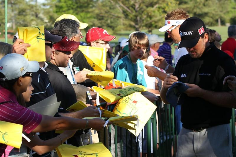 AUGUSTA, GA - APRIL 04:  Ian Poulter (L) of England and Graeme McDowell (R) of Northern Ireland sign autographs for fans during a practice round prior to the 2011 Masters Tournament at Augusta National Golf Club on April 4, 2011 in Augusta, Georgia.  (Photo by Andrew Redington/Getty Images)