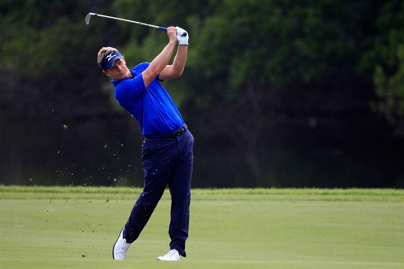 PONTE VEDRA BEACH, FL - MAY 11:  Luke Donald of England hits an approach shot during a practice round prior to the start of THE PLAYERS Championship held at THE PLAYERS Stadium course at TPC Sawgrass on May 11, 2011 in Ponte Vedra Beach, Florida.  (Photo by Sam Greenwood/Getty Images)