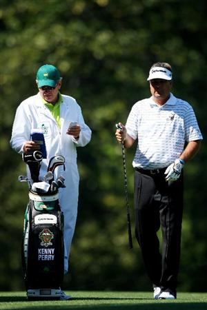 AUGUSTA, GA - APRIL 12:  Kenny Perry hands a club to his caddie Fred Sanders during the final round of the 2009 Masters Tournament at Augusta National Golf Club on April 12, 2009 in Augusta, Georgia.  (Photo by Andrew Redington/Getty Images)