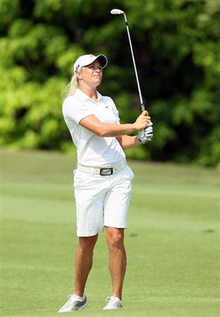 SINGAPORE - FEBRUARY 28:  Suzann Pettersen of Norway hits her third shot on the 5th hole during the final round of the HSBC Women's Champions at Tanah Merah Country Club on February 28, 2010 in Singapore, Singapore.  (Photo by Andy Lyons/Getty Images)