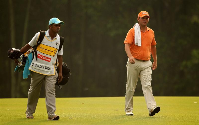 KUALA LUMPUR, MALAYSIA - MARCH 07:  Guido Van Der Valk of The Netherlands walks with his caddie on the tenth hole during the final round of the Maybank Malaysia Open at the Kuala Lumpur Golf & Country on March 7, 2010 in Kuala Lumpur, Malaysia.  (Photo by Ross Kinnaird/Getty Images)