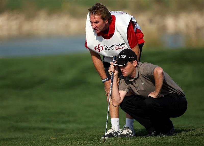 DOHA, QATAR - JANUARY 22:  Anders Hansen of Denmark lines up a putt with his caddie John McLaren on the 15th hole during the first round of  the Commercialbank Qatar Masters at Doha Golf Club on January 22, 2009 in Doha, Qatar.  (Photo by Andrew Redington/Getty Images)