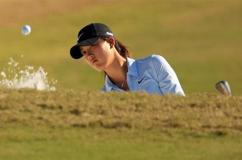 DAYTONA BEACH, FL - DECEMBER 06:  Michelle Wie plays a bunker shot on the 16th hole during the fourth round of the LPGA Qualifying School at LPGA International on December 6, 2008 in Daytona Beach, Florida.  (Photo by Scott Halleran/Getty Images)