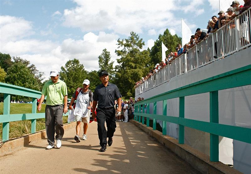 ST. LOUIS - SEPTEMBER 07: (L-R) Tim Clark and K.J. Choi walk across the bridge on the 14th hole during the final round of the BMW Championship on September 7, 2008 at Bellerive Country Club in St. Louis, Missouri.  (Photo by Mike Ehrmann/Getty Images)