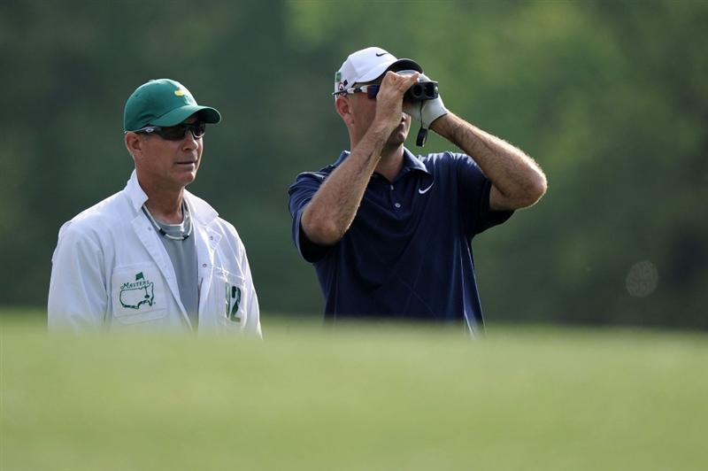 AUGUSTA, GA - APRIL 07:  Stewart Cink waits with his caddie Frank Williams during a practice round prior to the 2010 Masters Tournament at Augusta National Golf Club on April 7, 2010 in Augusta, Georgia.  (Photo by Harry How/Getty Images)
