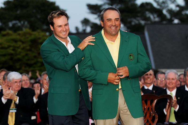 AUGUSTA, GA - APRIL 12:  Trevor Immelman of South Africa congratulates Angel Cabrera of Argentina during the green jacket presentation after Cabrera defeated Kenny Perry on the second sudden death playoff hole to win the 2009 Masters Tournament at Augusta National Golf Club on April 12, 2009 in Augusta, Georgia.  (Photo by Harry How/Getty Images)