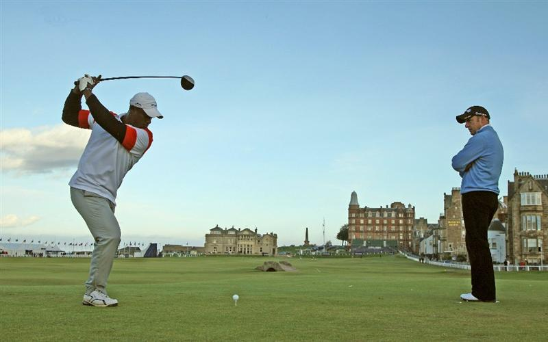 ST ANDREWS, SCOTLAND - SEPTEMBER 30: Manuel De Los Santos of the Dominican Republic drives off the 18th tee watched by Paul McGinley of Ireland during the final practice round of The Alfred Dunhill Links Championship at The Old Course on September 30, 2009 in St. Andrews, Scotland. (Photo by David Cannon/Getty Images  (Photo by David Cannon/Getty Images)