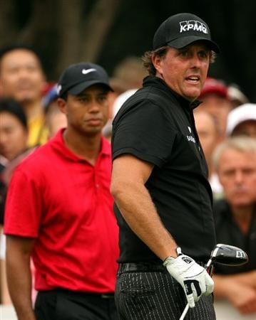 SHANGHAI, CHINA - NOVEMBER 08:  Phil Mickelson of the USA watches his tee-shot on the 13th hole as Tiger Woods of the USA looks on during the final round of the WGC-HSBC Champions at Sheshan International Golf Club on November 8, 2009 in Shanghai, China.  (Photo by Andrew Redington/Getty Images)