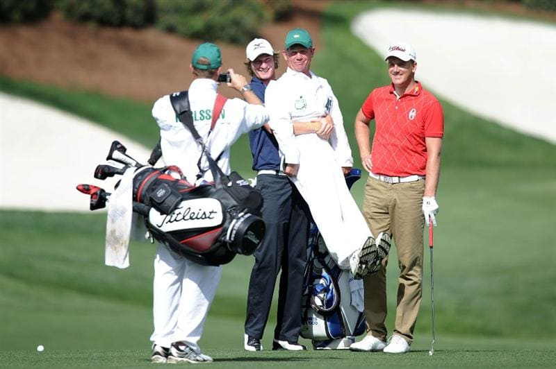 AUGUSTA, GA - APRIL 07:  Chris Wood of England clowns around with his caddie Dave McNeilly as Robert Karlsson of Sweden looks on  during a practice round prior to the 2010 Masters Tournament at Augusta National Golf Club on April 7, 2010 in Augusta, Georgia.  (Photo by Harry How/Getty Images)