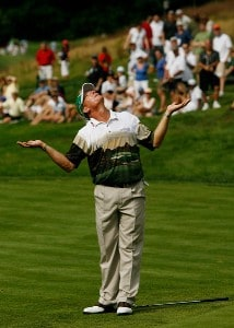 Woody Austin reacts to missing a short chip for birdie on the 12th hole during the final round of The Barclays, the inaugural event of the new PGA TOUR Playoffs for the FedExCup at Westchester Country Club on August 26, 2007 in Harrison, New York. PGA TOUR - 2007 The Barclays - Final RoundPhoto by Travis Lindquist/WireImage.com
