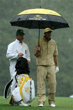 AUGUSTA, GA - APRIL 12:  Geoff Ogilvy of Australia waits with his caddie Allistair Matheson on the fifth hole during the third round of the 2008 Masters Tournament at Augusta National Golf Club on April 12, 2008 in Augusta, Georgia.  (Photo by David Cannon/Getty Images)