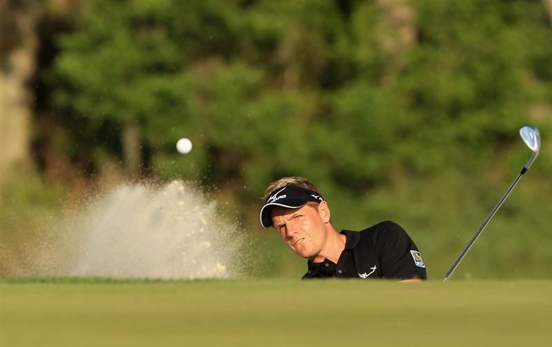 HILTON HEAD ISLAND, SC - APRIL 24:  Luke Donald of England hits from the sand on the 17th hole during a playoff in the final round of The Heritage at Harbour Town Golf Links on April 24, 2011 in Hilton Head Island, South Carolina.  (Photo by Streeter Lecka/Getty Images)