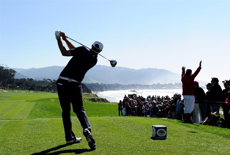 PEBBLE BEACH, CA - FEBRUARY 14:  Dustin Johnson plays his tee on the 10th hole during the final round of the AT&T Pebble Beach National Pro-Am at Pebble Beach Golf Links on February 14, 2010 in Pebble Beach, California.  (Photo by Stuart Franklin/Getty Images)