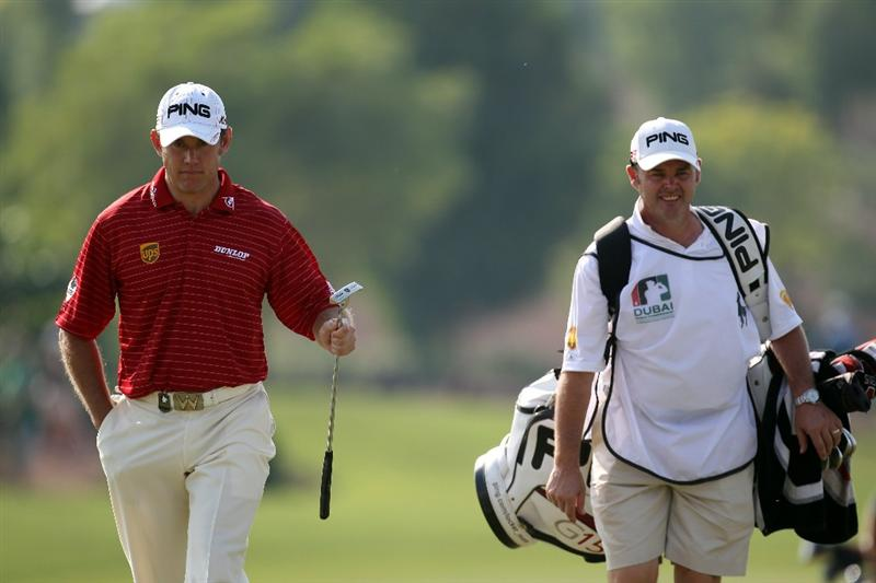 DUBAI, UNITED ARAB EMIRATES - NOVEMBER 27:  Lee Westwood of England and his caddie Billy Foster during third round of the Dubai World Championship on the Earth Course, Jumeirah Golf Estates on November 27, 2010 in Dubai, United Arab Emirates.  (Photo by Ross Kinnaird/Getty Images)