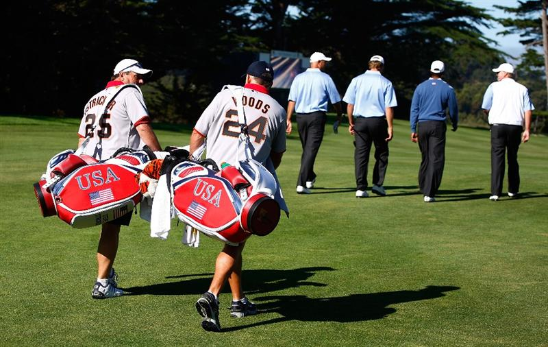 SAN FRANCISCO - OCTOBER 07:  Caddies Steve Williams, (R) and Jimmy Johnson walk up a fairway with their players during a practice round prior to the start of The Presidents Cup at Harding Park Golf Course on October 7, 2009 in San Francisco, California.  (Photo by Scott Halleran/Getty Images)
