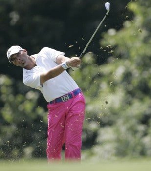 Hank Kuehne hits and iron on the sixth hole during the final round of the John Deere Championship at the TPC at Deere Run, July 10, 2005. Dameron finished tied for second place.Photo by Sam Greenwood/WireImage.com
