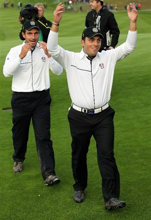 NEWPORT, WALES - OCTOBER 03:  Francesco Molinari of Europe celebrates holing a putt for a half in his match on the 18th green with Edoardo Molinari (L) during the  Fourball & Foursome Matches during the 2010 Ryder Cup at the Celtic Manor Resort on October 3, 2010 in Newport, Wales.  (Photo by Jamie Squire/Getty Images)