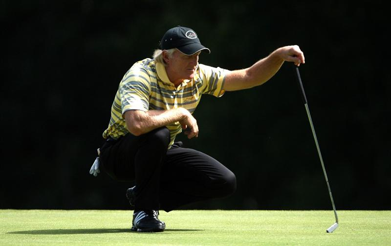 SUNNINGDALE, ENGLAND - JULY 23:  Greg Norman of Australia lines up a putt on the tenth hole during the first round of The Senior Open Championship presented by MasterCard held on the Old Course at Sunningdale Golf Club on July 23, 2009 in Sunningdale, England.  (Photo by Andrew Redington/Getty Images)