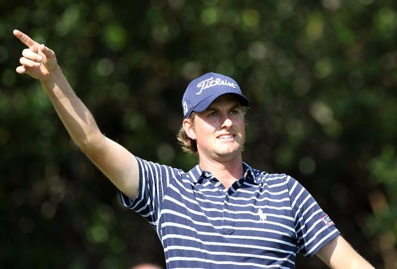 PALM HARBOR, FL - MARCH 20:  Webb Simpson points after a shot on the 11th hole during the final round of the Transitions Championship at Innisbrook Resort and Golf Club on March 20, 2011 in Palm Harbor, Florida.  (Photo by Sam Greenwood/Getty Images)