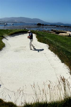 PEBBLE BEACH, CA - JUNE 16:  Zach Johnson hits a bunker shot during a practice round prior to the start of the 110th U.S. Open at Pebble Beach Golf Links on June 16, 2010 in Pebble Beach, California.  (Photo by Donald Miralle/Getty Images)