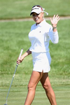SPRINGFIELD, IL - JUNE 04:  Natalie Gulbis smiles after making a birdie putt on the fifth hole green during the first round of the LPGA State Farm Classic golf tournament at Panther Creek Country Club on June 4, 2009 in Springfield, Illinois.  (Photo by Christian Petersen/Getty Images)