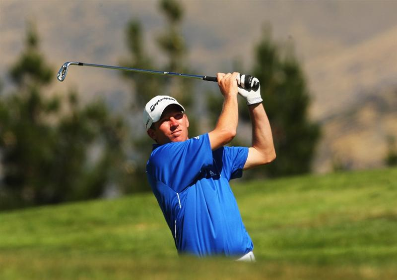 QUEENSTOWN, NEW ZEALAND - MARCH 14:  Jim Herman of the USA plays an approach shot on the 18th hole during day three of the New Zealand Men's Open Championship at The Hills Golf Club on March 14, 2009 in Queenstown, New Zealand.  (Photo by Phil Walter/Getty Images)