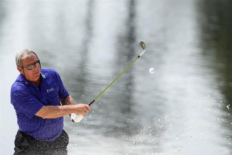AUGUSTA, GA - APRIL 07:  Fuzzy Zoeller hits from a bunker during the Par 3 Contest prior to the 2010 Masters Tournament at Augusta National Golf Club on April 7, 2010 in Augusta, Georgia.  (Photo by Andrew Redington/Getty Images)