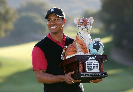 THOUSAND OAKS, CA - DECEMBER 16:  Tiger Woods poses with the winner's trophy after winning the Target World Challenge at the Sherwood Country Club on December 16, 2007 in Thousand Oaks, California.  (Photo by Robert Laberge/Getty Images)