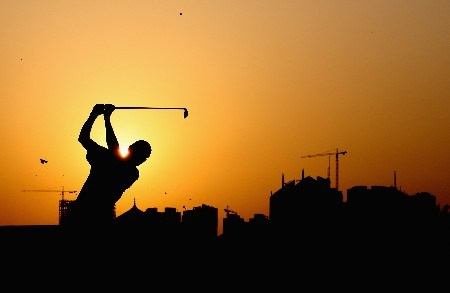 DUBAI, UNITED ARAB EMIRATES - JANUARY 31:  Andrew McLardy of South Africa plays his second shot to the par four 9th hole during the first round of the Dubai Desert Classic on the Majlis Course held at the Emirates Golf Club on January 31, 2008 in Dubai,United Arab Emirates.  (Photo by Ross Kinnaird/Getty Images)