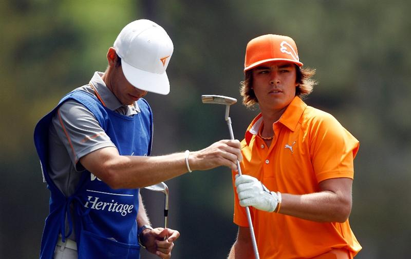 HILTON HEAD ISLAND, SC - APRIL 18:  Rickie Fowler takes his putter from his caddie during the final round of the Verizon Heritage at the Harbour Town Golf Links on April 18, 2010 in Hilton Head lsland, South Carolina.  (Photo by Scott Halleran/Getty Images)