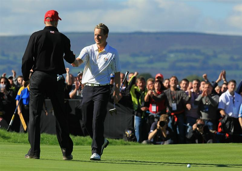 NEWPORT, WALES - OCTOBER 04:  Luke Donald of Europe is congratulated by Jim Furyk (L) of the USA after he won his match on the 18th green in the singles matches during the 2010 Ryder Cup at the Celtic Manor Resort on October 4, 2010 in Newport, Wales.  (Photo by David Cannon/Getty Images)