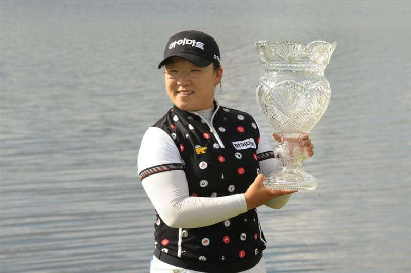 WEST PALM BECH, FL - NOVEMBER 23:  Ji-Yai Shin poses with the trophy after a one-stroke victory at the ADT Championship at the Trump International Golf Club on November 23, 2008 in West Palm Beach Florida.  (Photo by Montana Pritchard/Getty Images)