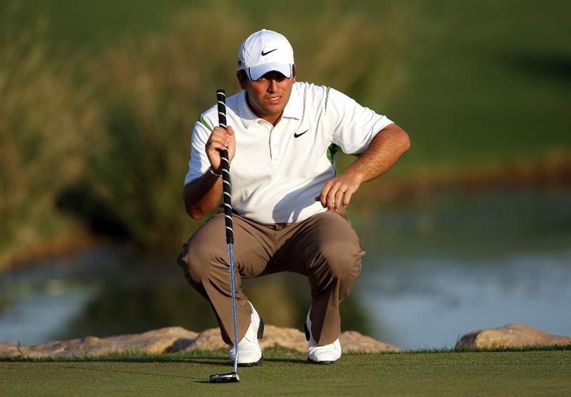 VILAMOURA, PORTUGAL - OCTOBER 17:  Francesco Molinari of Italy lines up a putt on the 18th hole during the third round of the Portugal Masters at the Oceanico Victoria Golf Course on October 17, 2009 in Vilamoura, Portugal.  (Photo by Andrew Redington/Getty Images)