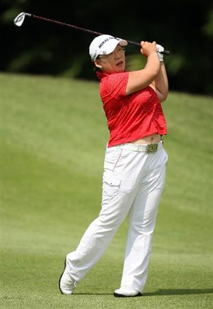SINGAPORE - MARCH 08:  Jiyai Shin of South Korea plays her second shot on the 4th hole during the final round of HSBC Women's Champions at the Tanah Merah Country Club on March 8, 2009 in Singapore.  (Photo by Ross Kinnaird/Getty Images)