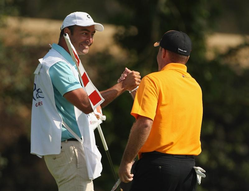 GIRONA, SPAIN - MAY 03:  Thomas Levet of France is congratulated by his caddie after a birdie on the 17th en-route to winning the Open de Espana on a score of -18 under par at the PGA Golf Catalunya on May 3, 2009 in Girona, Spain.  (Photo by Warren Little/Getty Images)