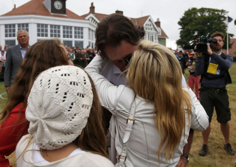 Phil Mickelson is greeted by his family following a final round 66 at the 2013 British Open.