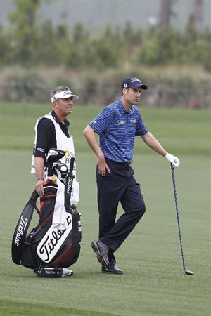 HUMBLE, TX - APRIL 01:  Ross Fisher of England (R) prepares to play a shot during the second round of the Shell Houston Open at Redstone Golf Club on April 1, 2011 in Humble, Texas.  (Photo by Michael Cohen/Getty Images)