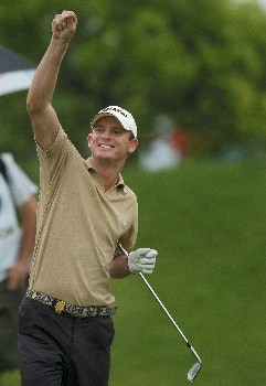 Adam Groom from Australia celebrates a birdie putt during round 4. BMW Asian Open, Tomson Golf Club Shanghai China RD4 May 1st 2005Photo by Jeff Crow/WireImage.com