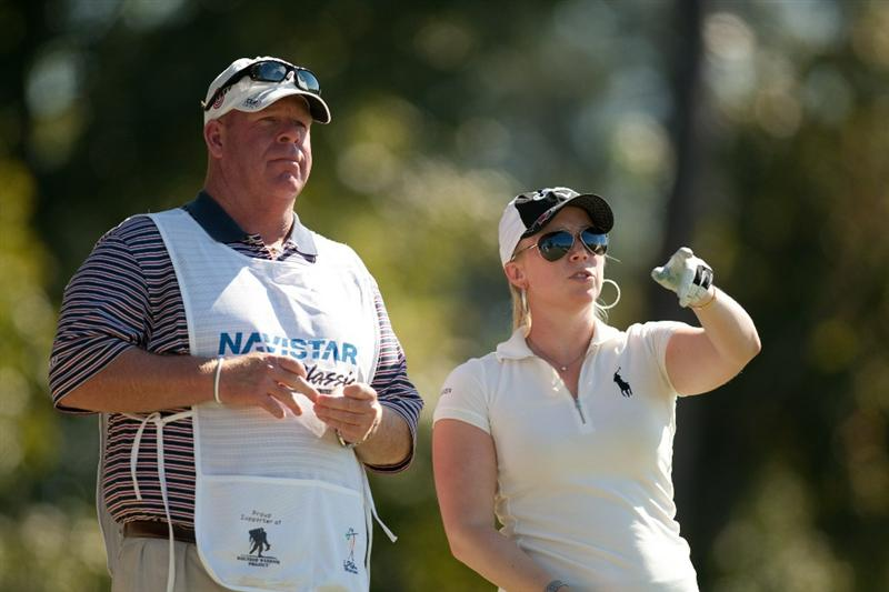 PRATTVILLE, AL - OCTOBER 7: Morgan Pressel (R) and caddie Barry Cesarz discuss yardage during the first round of the Navistar LPGA Classic at the Senator Course at the Robert Trent Jones Golf Trail at Capitol Hill on October 7, 2010 in Prattville, Alabama. (Photo by Darren Carroll/Getty Images)