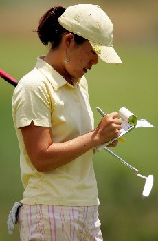 MORELIA, MEXICO - APRIL 28:  Angela Park of the United States marks her scorecard on the third green during the third round of the Corona Championship April 28, 2007 at Tres Marias Club de Golf in Morelia, Michoacan, Mexico.  (Photo by Matthew Stockman/Getty Images)
