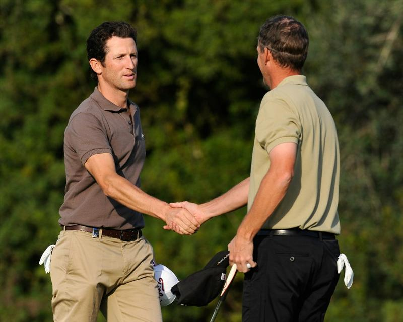 CASTELLON DE LA PLANA, SPAIN - OCTOBER 22:  Gregory Bourdy of France shakes hands with playing partner Anders Hansen of Denmark on the nineth hole during the second round of the Castello Masters Costa Azahar at the Club de Campo del Mediterraneo on October 22, 2010 in Castellon de la Plana, Spain.  (Photo by Stuart Franklin/Getty Images)