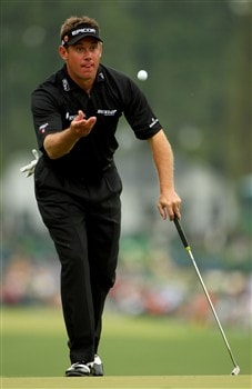AUGUSTA, GA - APRIL 12:  Lee Westwood of England tosses his golf ball on the first green during the third round of the 2008 Masters Tournament at Augusta National Golf Club on April 12, 2008 in Augusta, Georgia.  (Photo by Andrew Redington/Getty Images)