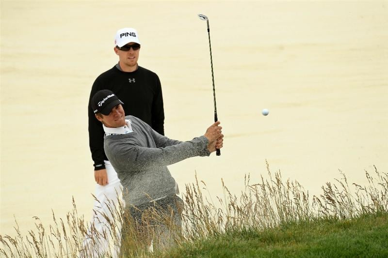 PEBBLE BEACH, CA - JUNE 15:  Sean O'Hair (bottom) plays from a bunker as Hunter Mahan looks on during a practice round prior to the start of the 110th U.S. Open at Pebble Beach Golf Links on June 15, 2010 in Pebble Beach, California.  (Photo by Ross Kinnaird/Getty Images)