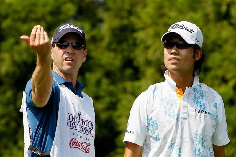 ATLANTA - SEPTEMBER 23:  Kevin Na of South Korea (R) talks with his caddie Don Donatello (L) before playing his tee shot on second hole during the first round of THE TOUR Championship presented by Coca-Cola at East Lake Golf Club on September 23, 2010 in Atlanta, Georgia.  (Photo by Kevin C. Cox/Getty Images)