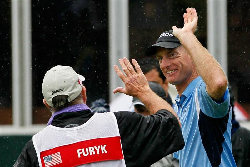 ATLANTA - SEPTEMBER 26:  Jim Furyk (R) and caddie Mike 'Fluff' Cowan (L) celebrate Furyk winning the FedExCup and THE TOUR Championship presented by Coca-Cola, the final event of the PGA TOUR Playoffs for the FedExCup, at East Lake Golf Club on September 26, 2010 in Atlanta, Georgia.  (Photo by Kevin C. Cox/Getty Images)