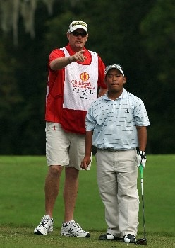 ORLANDO, FLORIDA - NOVEMBER 01:  Tadd Fujikawa  the 16 year old from Hawaii, with his caddie on the 11th tee on the Palm Course during the first round of The Childrens Miracle Network Classic held on the Palm and Magnolia Courses at The Disney Shades of Green Resort, on November 1, 2007 in Orlando, Florida,  (Photo by David Cannon/Getty Images)