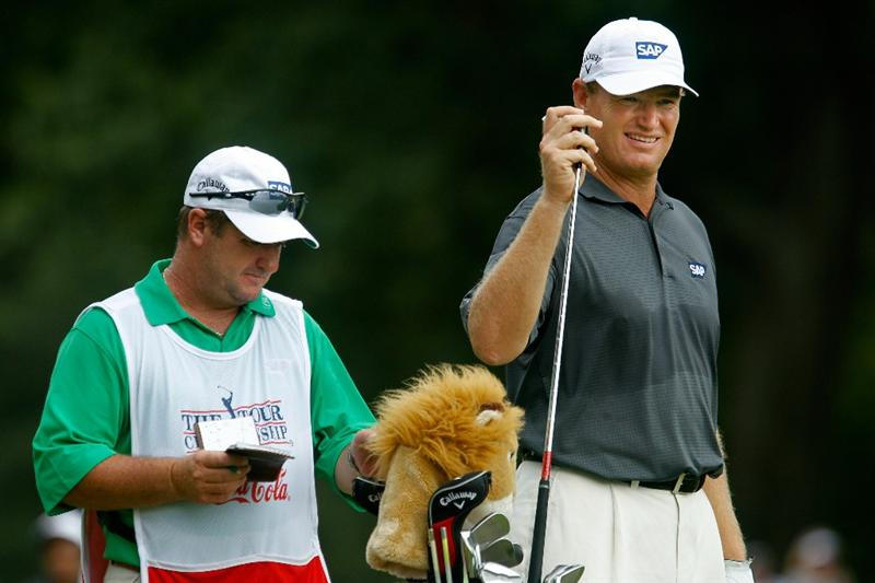 ATLANTA - SEPTEMBER 24:  Ernie Els of South Africa (R) pulls a club from his bag while alongside caddie Ricci Roberts (L) on the 14th hole during the second round of THE TOUR Championship presented by Coca-Cola at East Lake Golf Club on September 24, 2010 in Atlanta, Georgia.  (Photo by Scott Halleran/Getty Images)